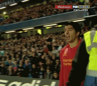 Luis Suárez celebrates his goal against Chelsea and looks lonely without team-mates