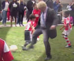 Mayor of London Boris Johnson trips child during a kids football match outside his office