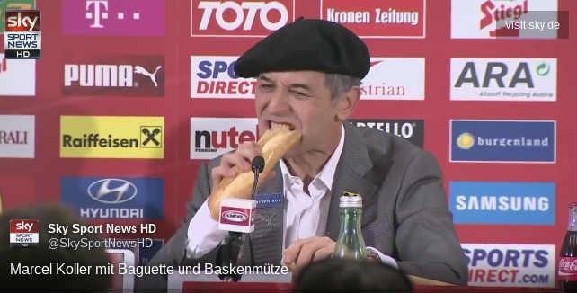 Austria coach eats baguette