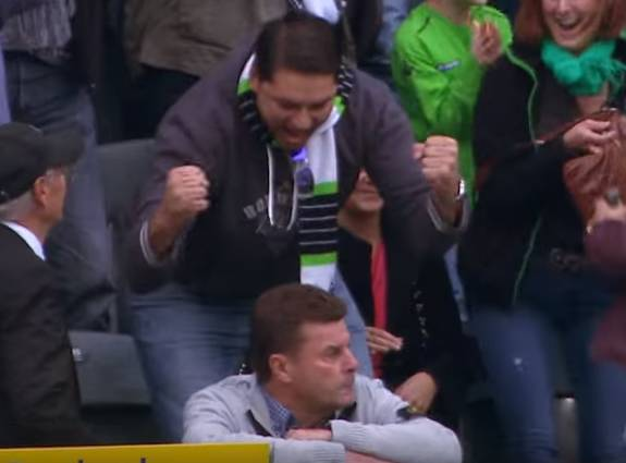 Dieter Hecking the Wolfsburg manager sits with opposition fans during his side's 2-0 defeat at Borussia Mönchengladbach in the Bundesliga