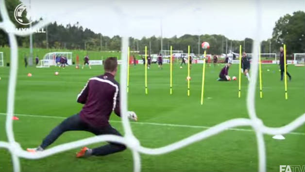 England goalkeeping coach impales ball on spike in amazing scene