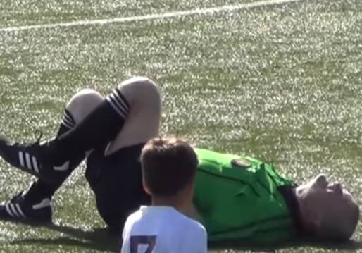 The referee hit in the nuts by a ball during a children's match