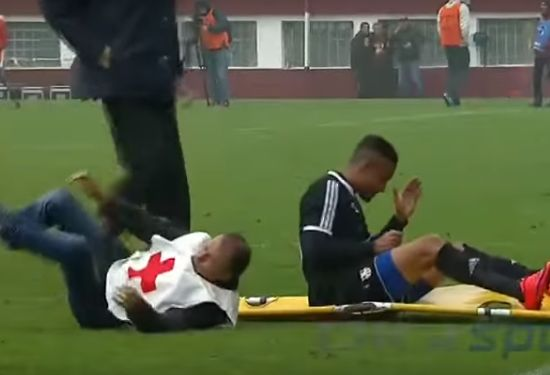 Romanian stretcher bearer trips and drops Otelul Galati's injured Cheick Diarra