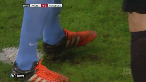 FC Augsburg goalkeepr Marwin Hitz scuffs the penalty spot, leading to Anthony Modeste slipping and missing