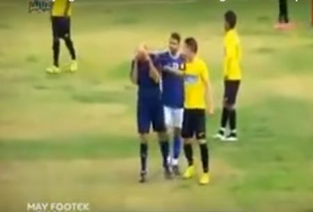 Players comfort the crying referee in a Tunisian league game between CA Bizertin and AS Marsa