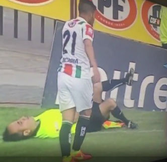 Chilean linesman fakes injury to get player sent off