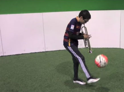 VIDEO: 11-year-old does kick-ups while playing trumpet