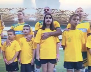 Craig Foster had an awkward hug with his daughter before a legends match between Australia and Liverpool