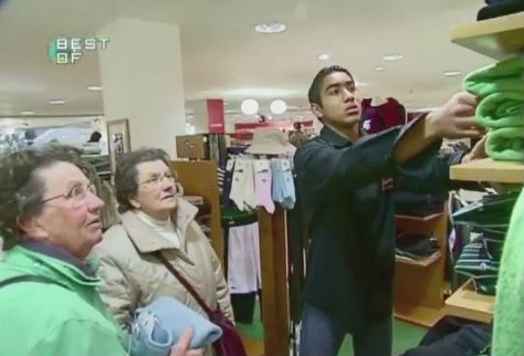 Dimitri Payet working in a clothes shop