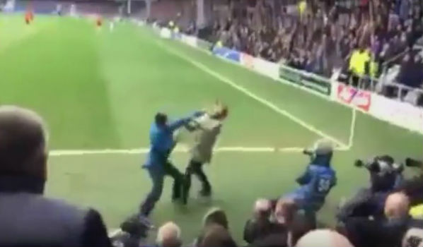 A QPR fan was punched in the face by a Birmingham supporter during the Hoops' 2-0 Championship win