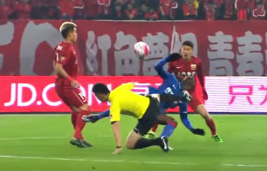 Former Newcastle and Chelsea striker Demba Ba gets clattered by the referee during a Chinese Super League match