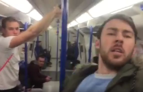 A lone Manchester City fan sings Blue Moon on the Tube after their 0-3 win at Chelsea