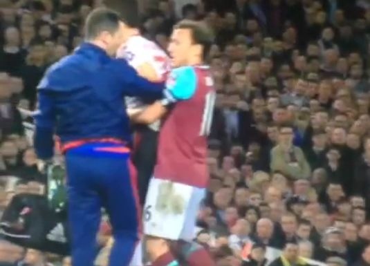 Mark Noble carries Herrera off the pitch during West Ham vs United FA Cup sixth-round replay