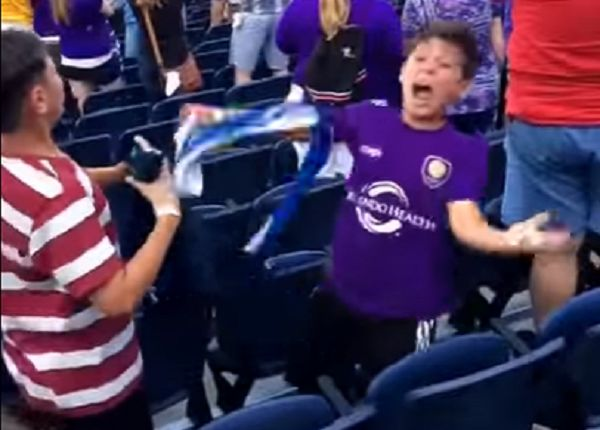 Child celebrates Orlando City goal against New England in stands at MLS game