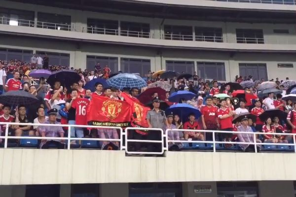 Chinese Manchester United fans sing 'F*** off City' at the Bird's Nest stadium in Beijing ahead of a friendly against Man City