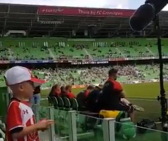 Young Dutch Southampton fan won't stop singing 'Shane Long's on Fire' into TV mic at FC Groningen friendly