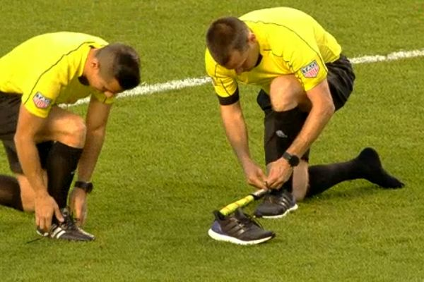 Two assistant referees swap shoes during MLS clash between Real Salt Lake and Chicago Fire