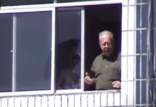 A player's shot breaks window of apartment overlooking ground during match