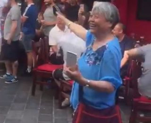 England fans sing 'Chicken chow mein, barmy army' with Chinese tourists outside a bar in Slovakia