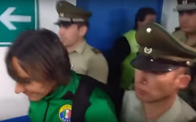 Sebastián Pol is arrested after the Audax Italiano player attacked a fan during a match