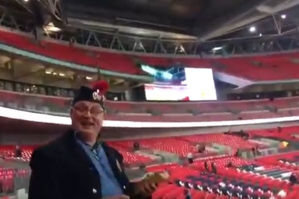 Scotland fan falls down stairs at Wembley with pint and hot dog before World Cup qualifier against England