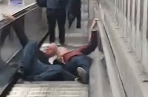 Stoke fans falling down escalator at Tube station after 1-1 draw at West Ham
