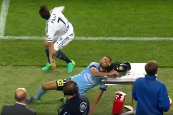 Sydney player hits head on table next to the pitch