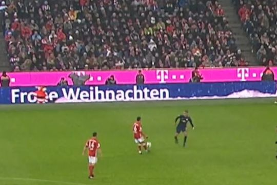 Bayern Munich's Thiago Alcântara pass to Santa Claus on the advertising boards during 3-0 win over RB Leipzig