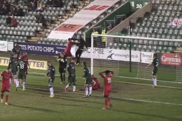 Liam Kelly, a Leyton Orient player pushes ballboy to the ground at Plymouth Argyle