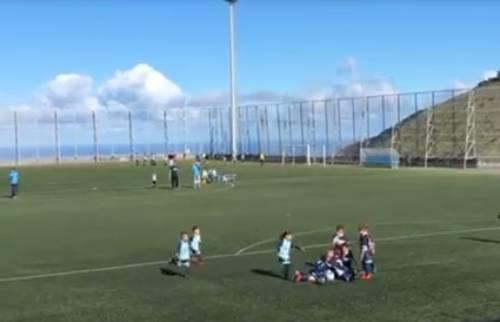 Both teams celebrate goal in children's match om Tenerife