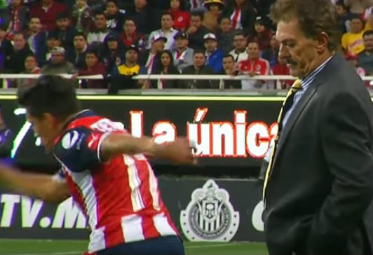 Manager Ricardo La Volpe trips opponent during Mexican match