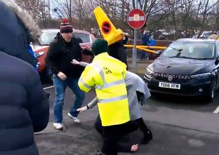 Woman hit by cone as fans fight following Huddersfield win over Leeds