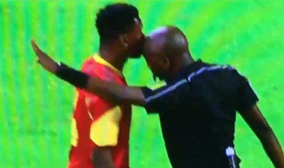 The referee headbutts a player during South Africa v Angola