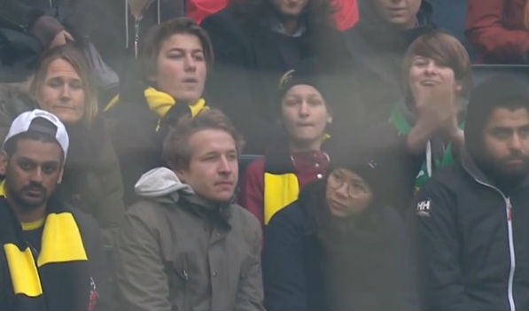 A young Hammarby fan claps his team's players in the AIK home end