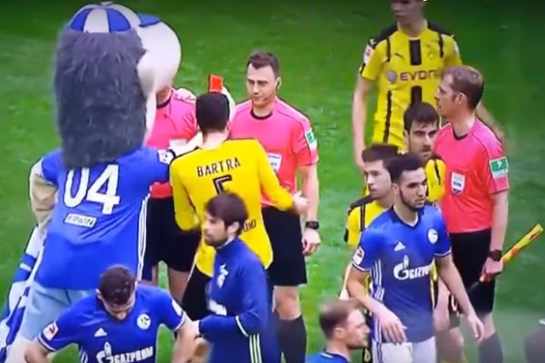 Erwin the Schalke mascot shows red card to referee following 1-1 draw with Dortmund at Veltins-Arena