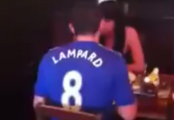 West Ham fans sing to man wearing Lampard Chelsea shirt eating dinner with a lady in a pub