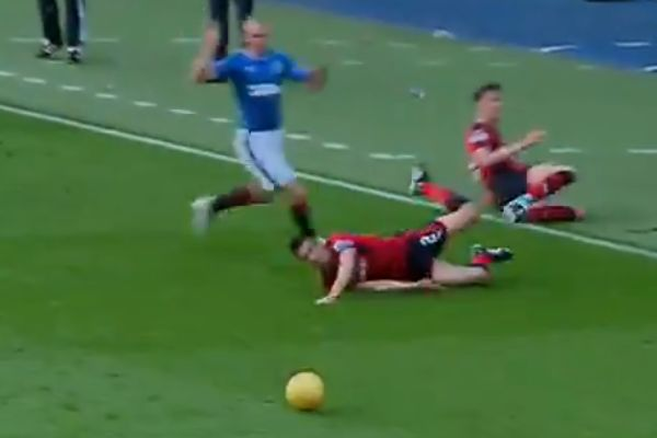 Jack Hendry, Dundee player slide tackles team-mate Cameron Kerr at Ibrox