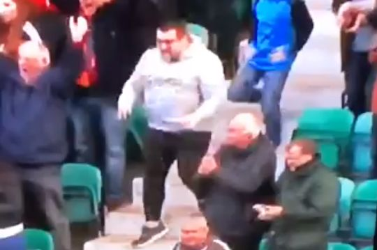 A celebrating Motherwell supporter slips on the stairs at Hibernian after their equaliser in the 2-2 draw