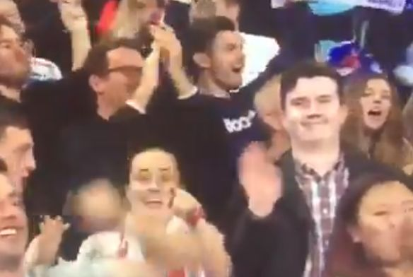 Man waves to the camera during England vs Slovakia, World Cup qualifier at Wembley