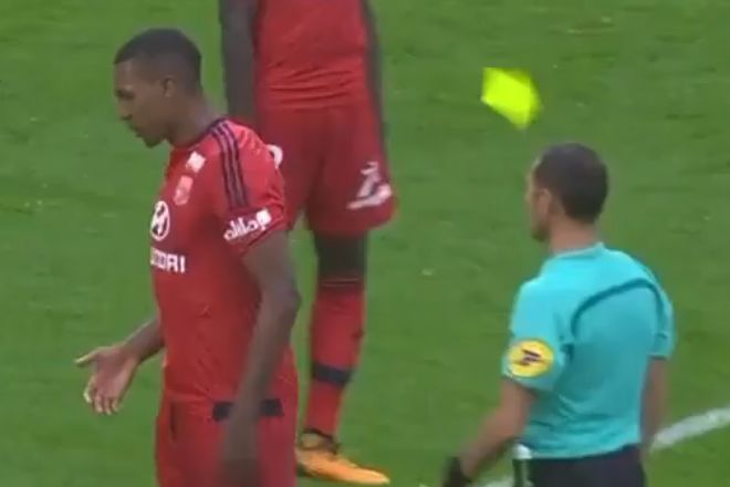 Lyon's Marcelo is sent off for knocking the yellow card out of the referee's hand