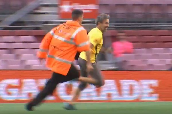 Pitch invader at empty Nou Camp for Barcelona vs Las Palmas that was played behind closed doors