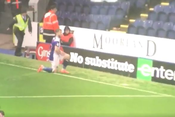 A steward trips over one of the advertising hoarding at Blackburn after Conway's goal against Portsmouth in their 3-0 win