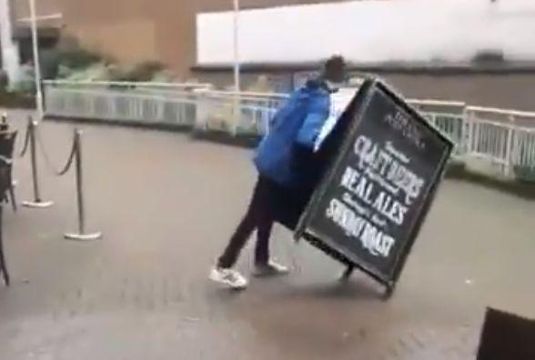 Nantwich Town fan falls into a pub sign in Stevenage