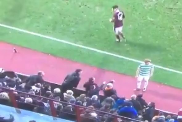 Hearts fans throw ball away from Celtic player before a throw-in in 4-0 win
