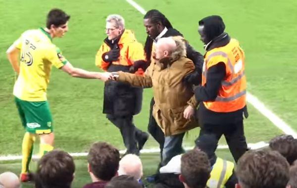 Norwich defender Timm Klose hands a fan back his cigarettes
