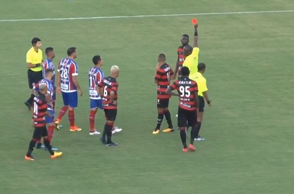 The referee shows one of ten red cards during Vitória v Bahia