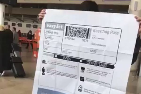 An England fan's huge boarding pass for a flight to Amsterdam prior to the friendly with Holland