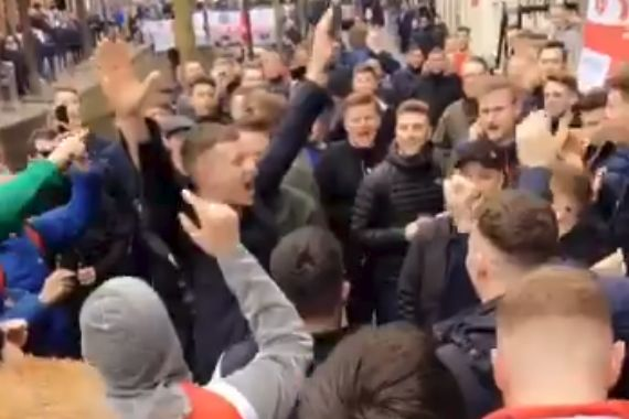 England fans cheer a supporter leaving an Amsterdam brothel