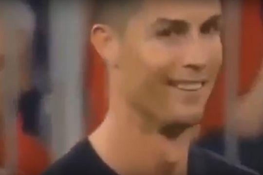 Cristiano Ronaldo smiles at a pitch invader after Bayern vs Real Champions League semi-final
