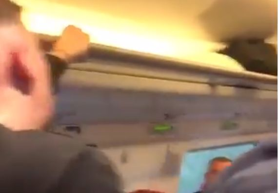 Arsenal fans argue on train after Man Utd defeat